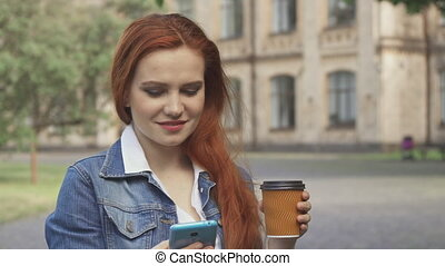 Female student drinks coffee on campus