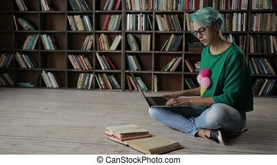 Female student e-learning online with laptop - Smart college...