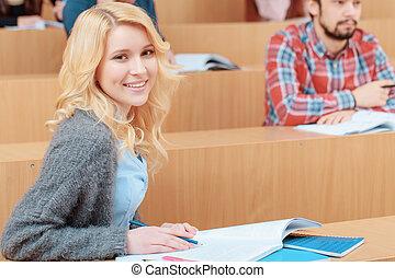 Female student in an auditorium