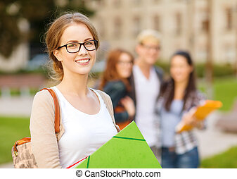 female student in eyglasses with folders