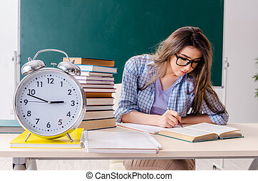 Female student in front of chalkboard