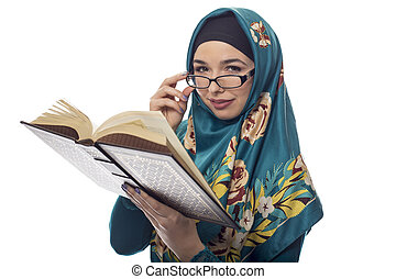 Female Student in Hijab Reading a Book