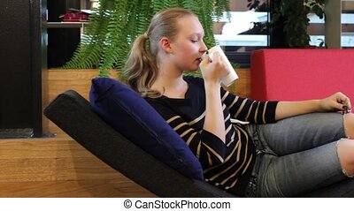 Female Student in Rest Room - Young female student or pupil...