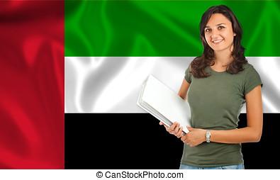 Female student over Arab flag