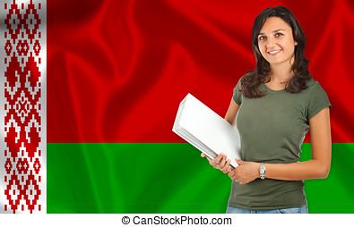 Female student over Belarusian flag