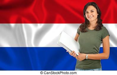Female student over Dutch flag