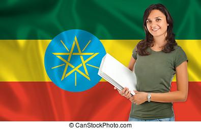 Female student over Ethiopia flag
