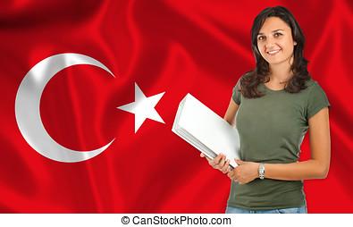 Female student over Turk flag