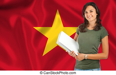 Female student over Vietnamese flag