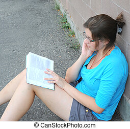Female student reading.