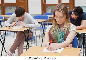 Female student sitting at table