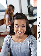 Female Student Smiling In Computer Class