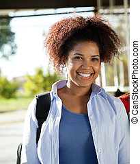 Female Student Smiling On College Campus