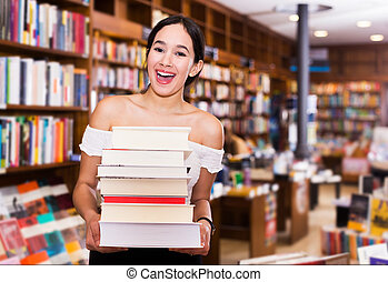 Female student standing in library
