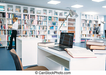 Female student studying in university library