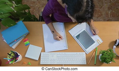 Female student studying tablet writing, education college...