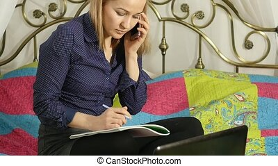 female student talking on smartphone with her teacher. on-line education at home. slow motion