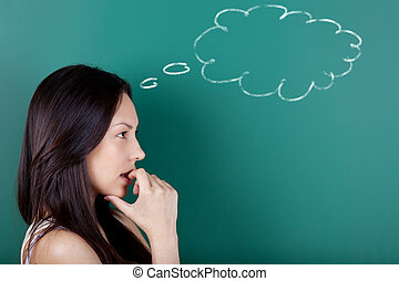 female student thinking of something - young woman with...