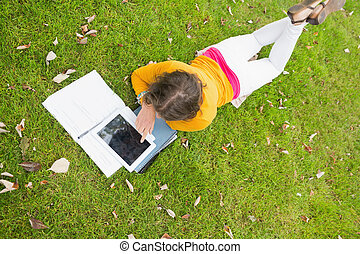 Female student using tablet PC in t