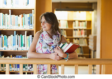 Female student with books in the library