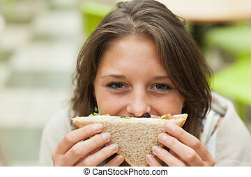 Female student with sandwich in the