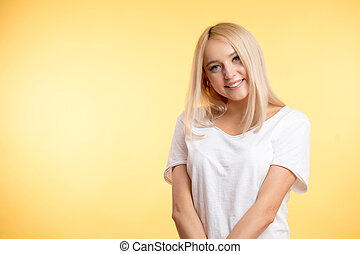 female student with straight blond healthy hair looking at the camera