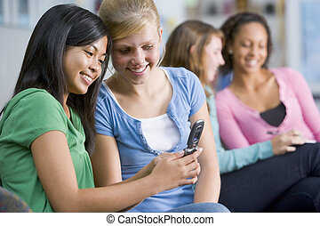 Female students looking at a mobile phone