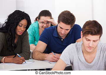 Female Students Trying To Cheat During Test - Female college...