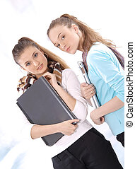 Female students with notebooks