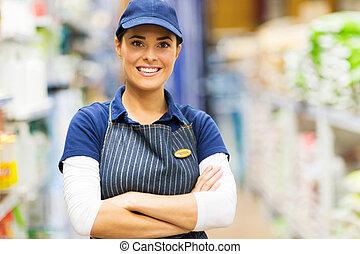 female supermarket worker portrait
