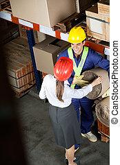 Female Supervisor Communicating With Foreman