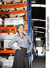 Female Supervisor Wearing Protective Eyeglasses At Warehouse