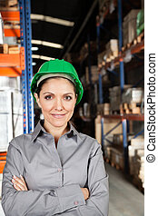 Female Supervisor With Arms Crossed At Warehouse