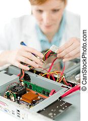 Female support computer engineer - woman repair