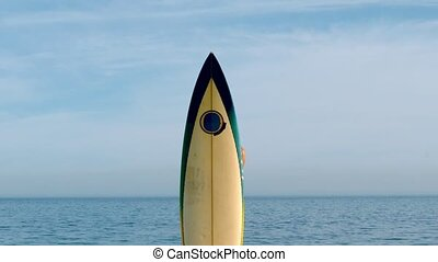 Female surfer leaping out from behind her board in slow...