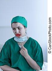 Female surgeon tired but joking