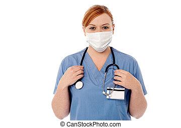 Female surgeon wearing face mask