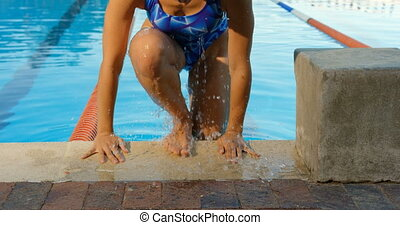 Female swimmer coming outside the pool 4k
