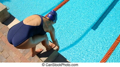 Female swimmer getting ready to swim 4k - Female swimmer ...