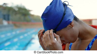 Female swimmer removing swim goggle 4k - Female swimmer ...