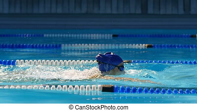 Female swimmer swimming inside pool 4k