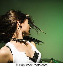 Female swinging hair. - Cuacasian female swinging her hair.