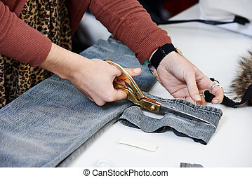 Female tailor hands at work