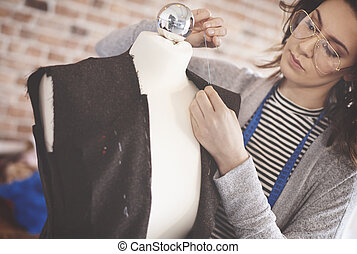 Female tailor pinning new project