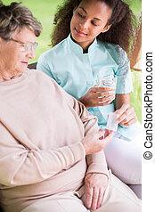 Female taking medicines