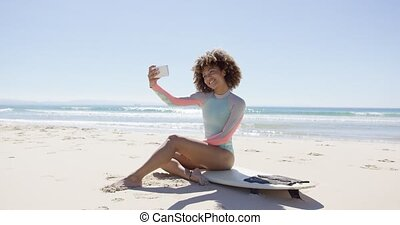 Female taking selfie on beach