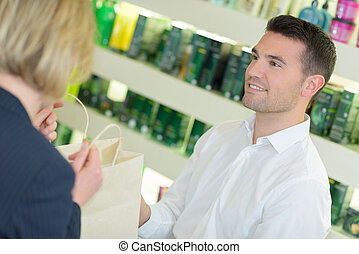 female talking to the pharmacist at the drugstore