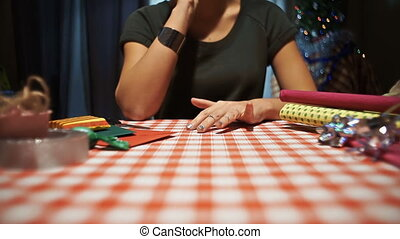 Female tapping fingers on the table, waiting for holiday