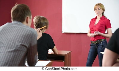 female teacher giving a lecture at the University