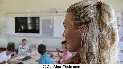 Female teacher smiling in the class - Caucasian female ...
